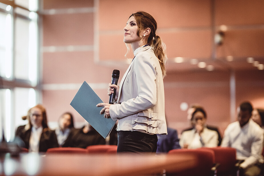 Woman confidently speaking to an audience
