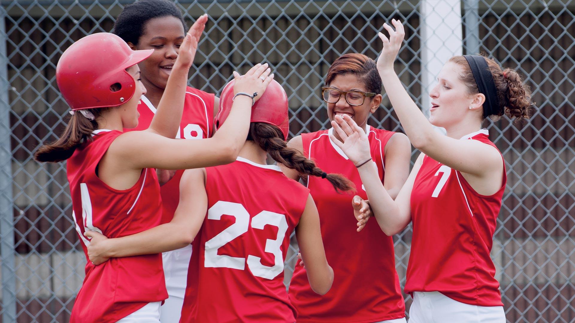 Softball players high five